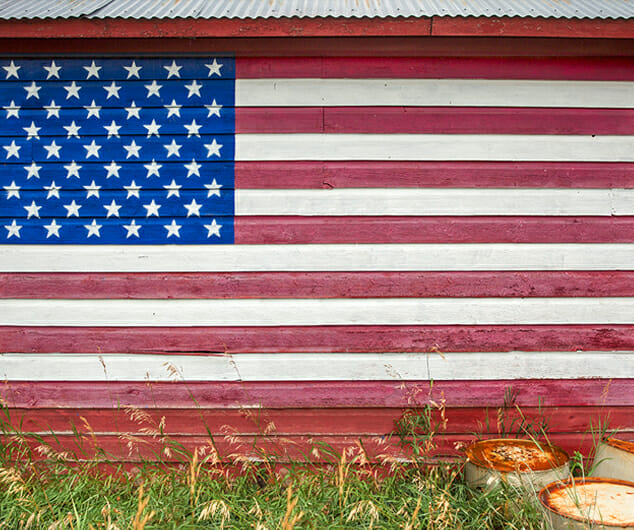 An American flag painted on the side of a barn